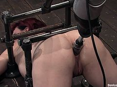 A hot redhead bitch gets fucked by a fucking machine in this hot bondage scene right here! Hit play and check it out, yo!