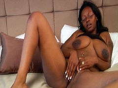 Spoiled black BBW lies on her back toying her puffy soaking twat with her fingers before she stands in doggy position to allow aroused white dude take her from behind.