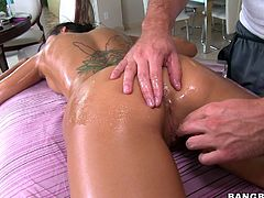Her oiled body, attractive boobs and shaved cunt can make anyone do what ever she wants. The massage is enjoying the same quantity of lust as this brunette slut. He is moving her hands around her whole body with a little rub in her boobs and pussy. Then she is returning the favor with a great blowjob.