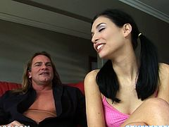 Adorable brunette babe gives a blowjob and a handjob to a guy with big dick. After that she lies down on a sofa and gets fucked rough.