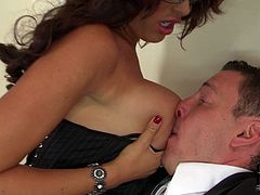 This four eyed brunette slut knows how to seduce a man! Busty nympho tempts her colleague with her big juicy melons and makes him worship them.