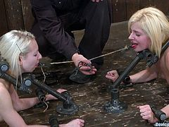 A couple of cute blonde babes are sex slaves and victims of a sadist domme in this kinky BDSM scene right here, check it out!