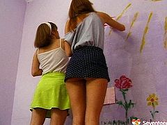 Two playful Russian lesbians found an interesting thing to do: they paint sun and flowers on the walls before they get naked to keep painting on their slender bodies. Later they head to the shower to wash off the results of their creativity.