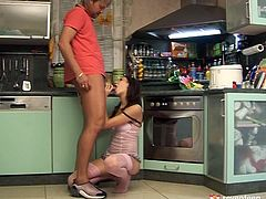 This young brunette slut knows how to treat a good, stiff cock. She gets down on her knees and sucks her boyfriend's dick with unbridled passion paying special attention to his balls. A bit later she gives him with the best footjob of his life with those perfect feet of hers. Since that pecker is already hard she jumps on top of it and rides it like mad.