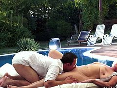 Young money greedy poodle-faker pleases a fat ruined granny by the pool. He oral strokes her quaggy big tits before h moves down to her hairy vagina to give a steamy tongue fuck.