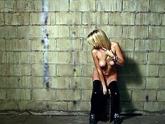 Sexy blonde Victoria Winters is having a photo shoot near a brick wall. She takes her clothes off and poses for the cam in her black stockings.