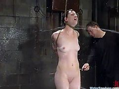 Rebellious brunette Nina is having fun with a stranger in a basement. She gets bound and showered and likes a big toy in her wet pussy.