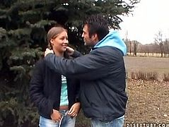 Frisky brunette amateur heads to the woods with a horny dude. She takes off her pants in front of him to pisses on the ground in perverse sex video by 21 Sextury.