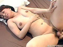 Hot Japanese milf pleases her man with a nice blowjob and lets him play with her tight cunt. Then she sits down on his prick and rides it crazily.
