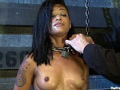 Sexy chick Skin Diamond is having fun with some guy in a basement. She lets the man put her into irons and then enjoys having his dick in her mouth.