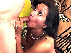 Kinky old bitch Persia Monir loves to suckle a big thick cock. She gobbles it nicely and takes it deep inside her moist hairy cunt while moaning with pleasure.