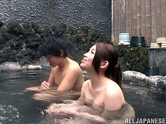 Japanese couple have a rest in outdoor hot tub. After some time the girl gives a blowjob and gets her tits licked. Then she gets her hairy pussy fingered and fucked from behind.