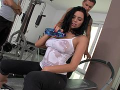 Kira Queen was working out when two attractive guys came. She immediately threw water on her big tits to give them a hint of what she wanted to do with them: have a DP threesome!