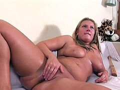 While horny dude tapes everything on cam, slutty blondie goes solo. Already naked oiled chick with droopy big tits and smooth rounded big ass gets busy with fisting her wet pussy too passionate on cam, as if it's the last chance to masturbate.