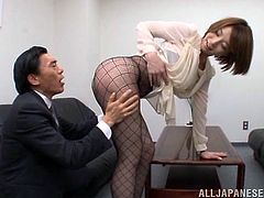 Tamaki Nakaoka knows the principal has the hots for her. She lets him have a close up view of her fishnet stockings and he rubs her legs. She rubs her ass in his face and lets him kiss it. She also lets him suck on her feet.