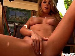 See the hot blonde temptress Brynn Tyler stripping off in the backyard and flaunting her hot body before fingering her shaved slit into kingdom come.