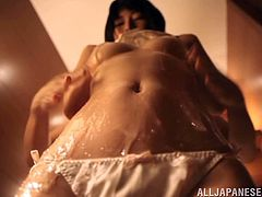 Kinky Japanese chick Chigusa Hara is having fun in a bathroom. She oils her nice body and strokes her boobs and ass passionately.