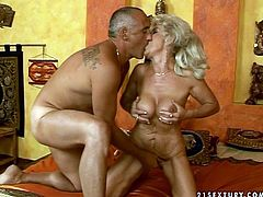 Horn-mad blond old slut goes wild tonight. She gets rid of nightie to show her huge fake boobs. Then wrinkled booty old slut kneels down to suck a dick and gets her mature cunt polished with a sex toy in return.