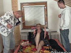This granny has no money to pay the delivery boys, so she pays by sucking their cocks and taking them in her old cunt.