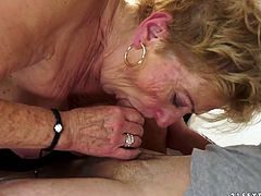 Lascivious granny is still craving for orgasm despite her age. She seduces young stud to satisfies her needs. So he enters her mound from behind boffing her bad doggy style.