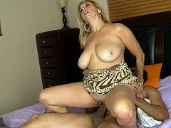 You'll be getting a serious boner as you lay your eyes on this blonde's big natural tits in this hardcore video where she sucks and fucks a big cock that leaves her with a messy facial.