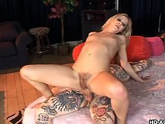 The tattooed guy shows this blonde slut what a real man can do with her body. She's being throated and then goes on top to ride him. His dick goes all the way in her butt and fills her up. Yeah, she's a fucking slut and loves to ride a hard cock with her tight anus!