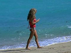 Playful curly blond chic takes a walk at the beach in steamy bikini. Later she shows off her big firm tits that will definitely drive you crazy in sultry sex video by Pornstar.