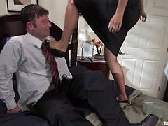 Hot office woman undresses and ties the guy up. After that she strokes his dick and toys the butt with a strap-on. Then she also gets her pussy licked.