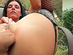 Hot lesbian brunette inserts a huge dildo in her pussy and another in her ass in a hot lesbian Anal