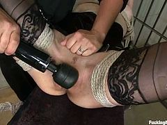 Lovely brunette in stockings gets bonded and toyed with a vibrator. After she gets wet enough she gets drilled by the fucking machine.