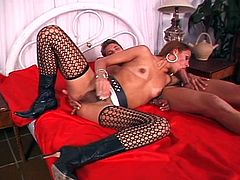 Tranny in stockings fucked hard as she gets stuffed with another hard cock deep inside her tight anal slit.
