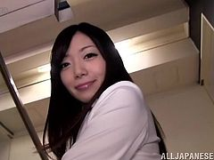 Kinky Japanese girl wearing pantyhose pulls her office skirt up and demonstrates her nice ass to her man. She teases the dude and seems to be proud of herself.