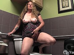 Jane is a mature slut with huge natural tits and a hairy twat. She climbs on the toilet and masturbates.
