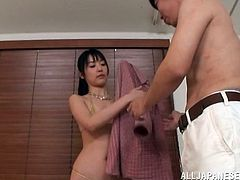 Japanese girl in bikini handcuffs and blindfolds some dude in a bathroom. Then she toys his nipples and dick with two vibrators.