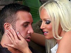 Tanned and hot blonde milf Diana Doll meets her sons coach Keiran Lee and gets her hands all over him, pleasing him with a nice blowjob on the couch in her living room.