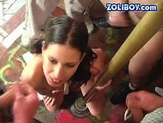 Bunch of horny overaged dudes surround a fuckable brunette MILF that stands on her knees. They jerk off looking at her naked body before they bukkake on her cute face in gangbang sex video by 21 Sextury.