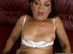 Ruined red-haired overage prostitute exposes her bushy cunt for a drill in missionary style before she gives tit fuck to strain dick in pov sex scene.