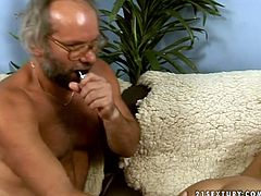 Horn-mad brunette undresses to boast of huge boobs. This spoiled nympho with big ass bends over the couch. Ugly bearded man comes closer to fuck her wet pussy with several sex toys, causing her loud moans.