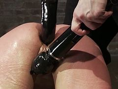This desirable and sizzling babe Amber Rayne is being tortured pretty hard! She gets hogtied and some huge toys penetrate her asshole and pussy.