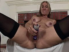 A mature woman gets naked for the camera and fucking inserts a hard toy in her pink motherfucking pussy, check it out right here!
