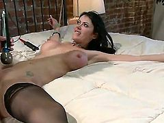 Busty gal Eva Karera is bound to a bed, gagged and her tits are clamped. Ramon Nomar drills her tender ass while teasing her muff with a vibrator.