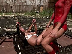 Pitiless brunette domina crucifies a cheesecake blondie before she starts tickling her soles and later poking her cunt with huge black dildo in BDSM-involved sex video by 21 Sextury.