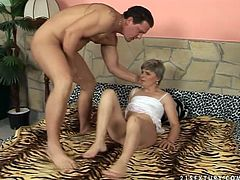 Voracious aunty lies flat on her back with her legs wide open. The guy inserts screwer with dildo head inside her clam drilling her cunt deep.