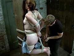 This sizzling and desirable redhead doll Sarah is being humiliated in a very refined way. She gets arched with ropes, being hanged up on the ceiling. Then she feels some hot drops of wax.