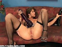 See a perverse brunette slut wearing fishnet stockings while dildoing her pussy with a huge toy in this awesome solo vid.