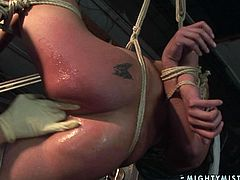 Perverse nurse is an experienced domina who used to please aroused hoes in a unique way. She hangs a curvy brunette in the air before she starts fisting her pussy in BDSM-styled sex clip by 21 Sextury.