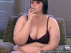 During a chit chatting, BBW brunette named Milla light a cigarette while she clad only in a two piece bikini that minutes later are down to show off her all natural big tits and her