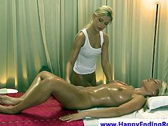Blonde lesbian masseuse models fingering on top of massage table