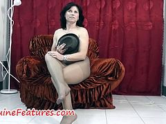 Watch the horny brunette milf Karin Lun as she strips off and flaunts her hot body while wearing a pair of sexy black pantyhose.