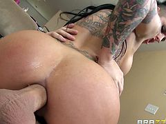 Alluring brunette with stunning forms gets her shaved ass nailed in anal hardcore